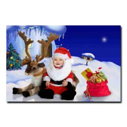 An adorable baby santa with his reindeer with baby Mrs. Claus in a wagon nearby.  Isolated on white.